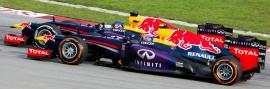 Sebastian_Vettel_overtaking_Mark_Webber_2013_Malaysia_3